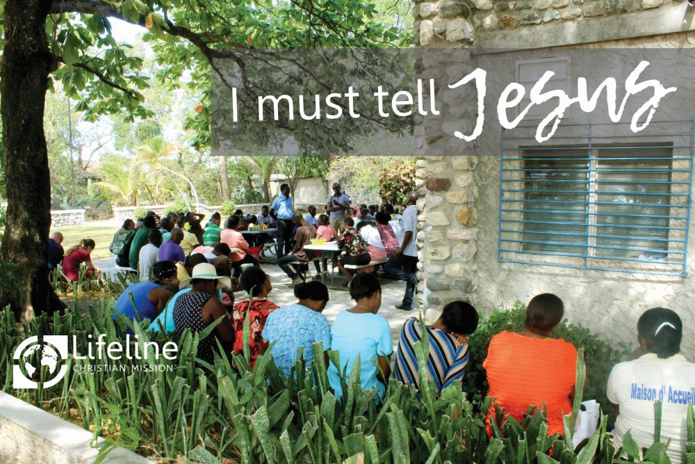 Haitian Staff Praying and Singing